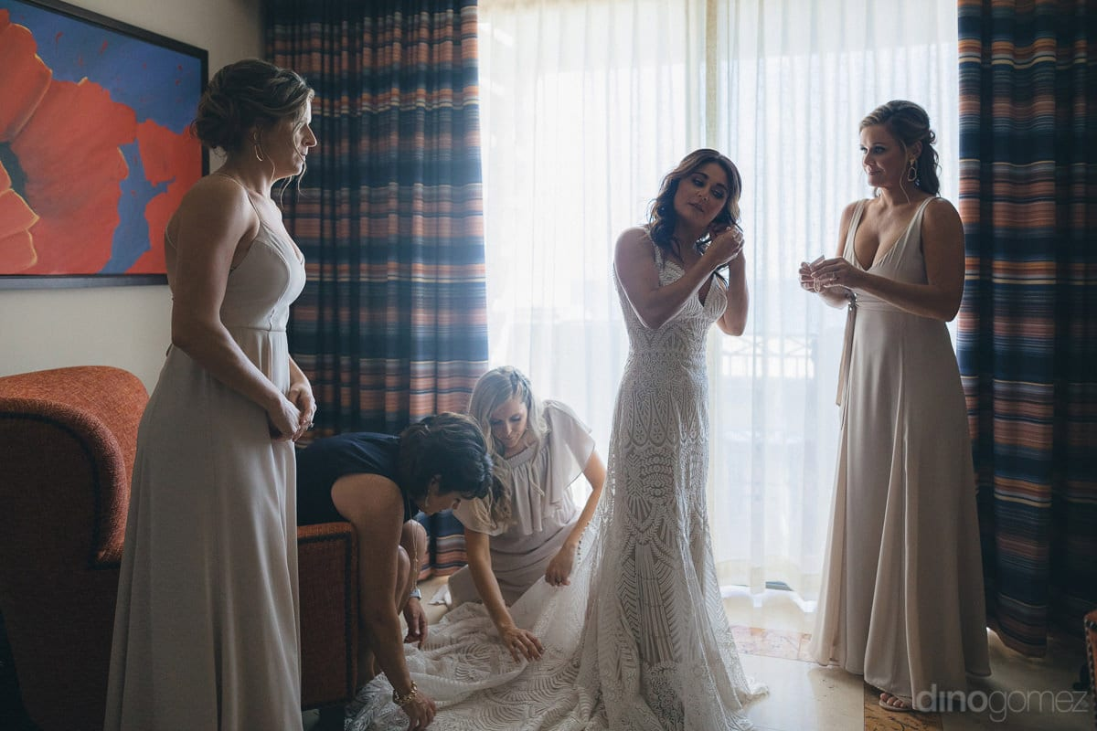 The Wonderful Bride Squad Can Be Seen Giving Final Touch To The Wedding Dress Of The Bride Before Leaving For The Wedding Venue- Kathleen & Kevin