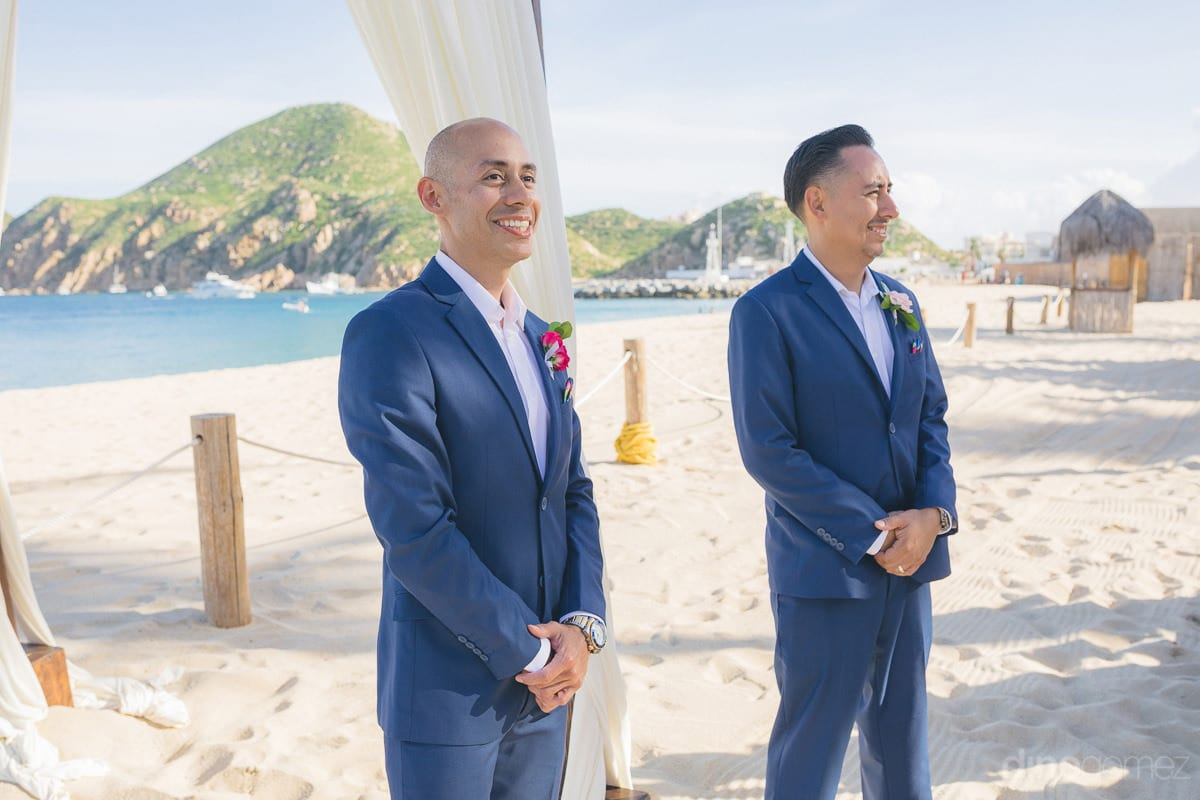 The groom and his bestman is dressed in blue suit and are happily waiting for the bride to arrive- Nikki and David