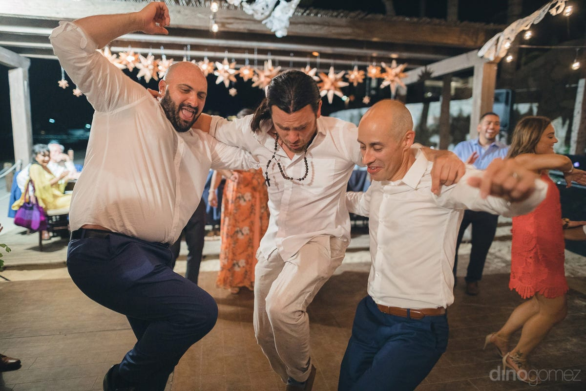 The groom along with two of his friends are dancing on the dance beats at the reception party- Nikki and David