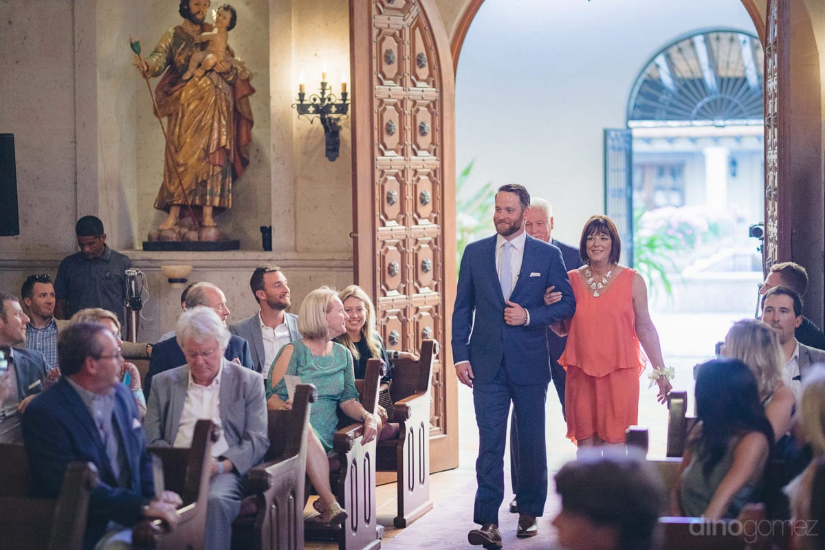 The groom dressed in blue suit and lovely smile is entering the wedding hall while holding hands of a sweet lady- Kathleen & Kevin