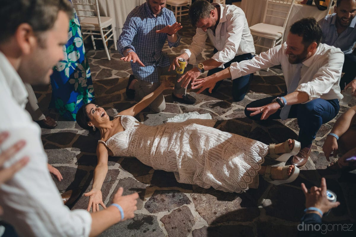 The Beautiful Bride Can Be Seen Lying On The Floor And Enjoying The Evening Party To The Fullest- Kathleen & Kevin
