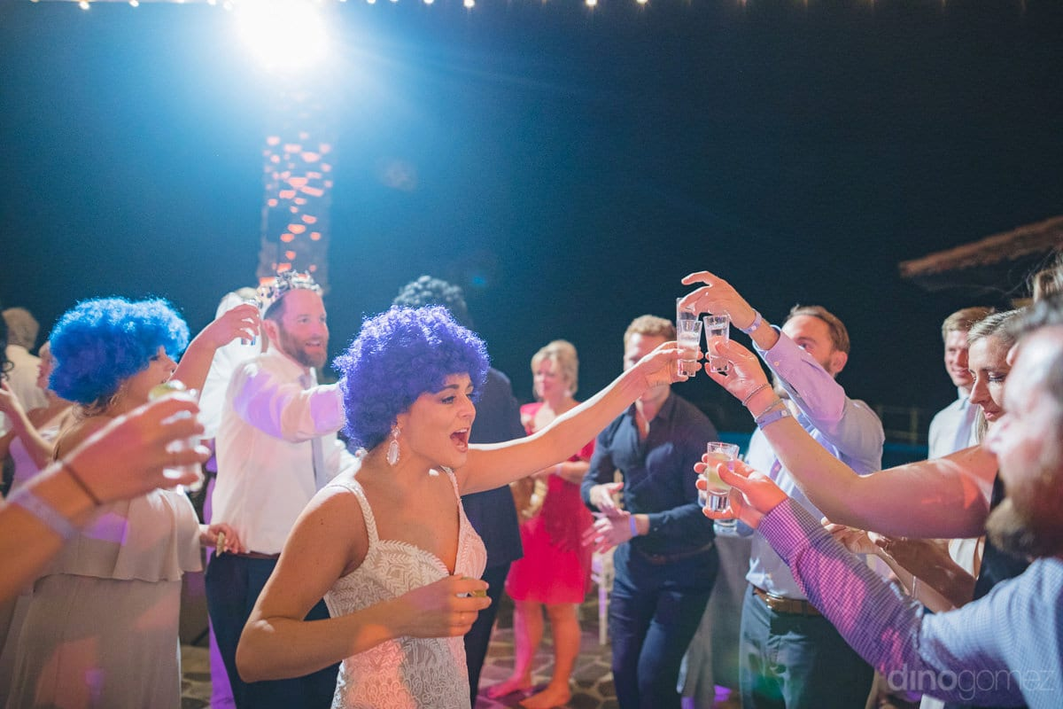 All the wedding guests can be seen enjoying drinks and dance party at the beachside to the fullest- Kathleen & Kevin