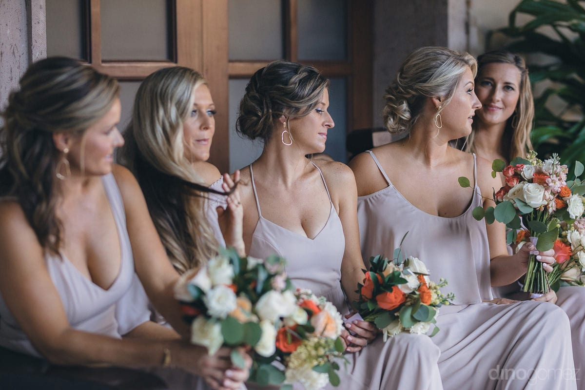 All the pretty bridemaids are sitting and giving a beautiful pose for the camera- Kathleen & Kevin