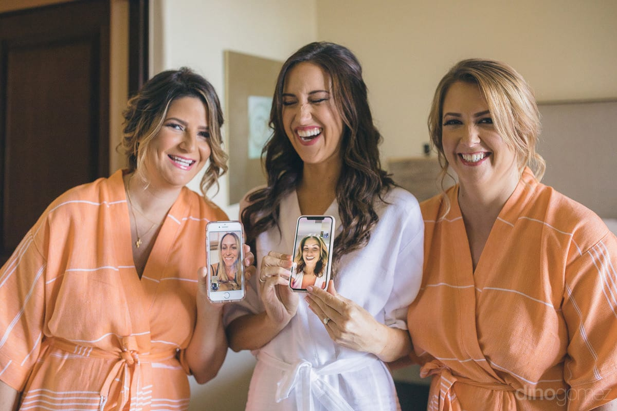 Gorgeous bride and her two friends are laughing while showing pictures of ladies in their phones to the camera- Nikki and David