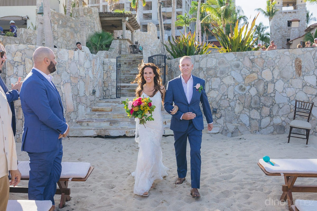 The gorgeous bride is all smiles while walking towards the wedding stage holding hands of a gentleman- Nikki and David