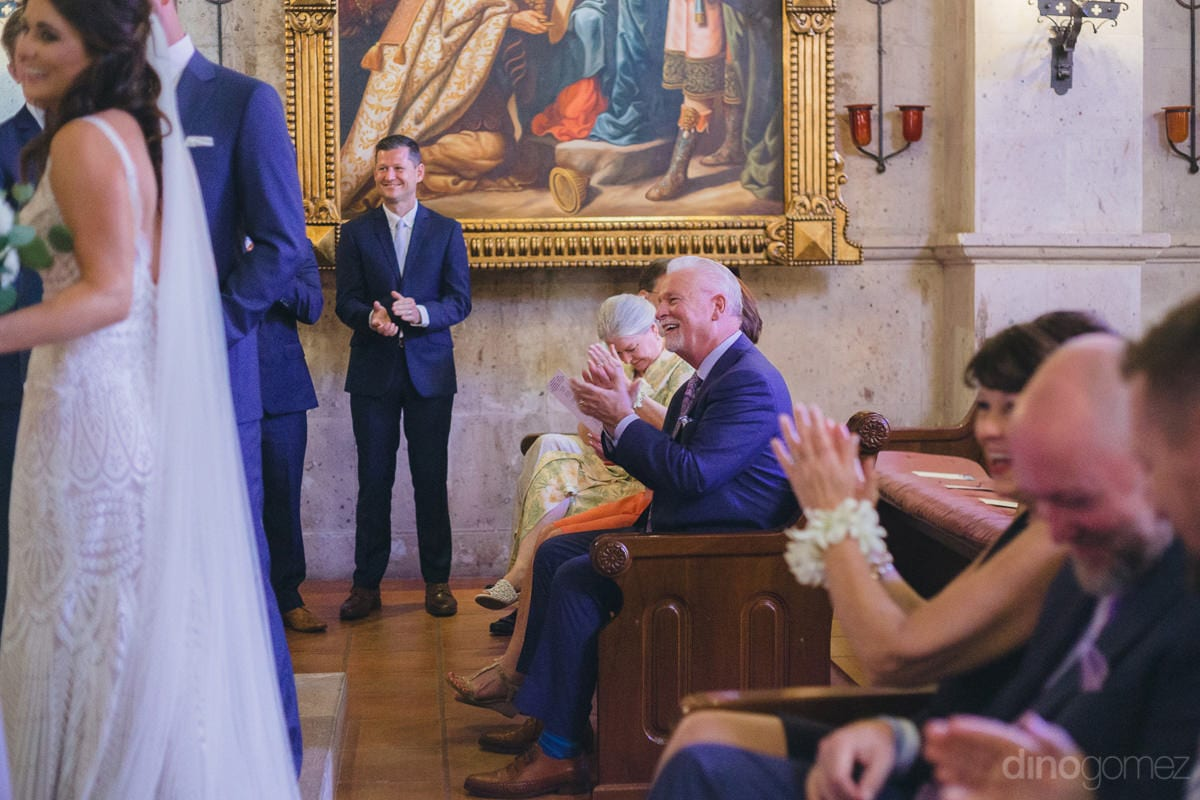 Picture captures the guests clapping during the wedding ceremony of the lovely couple- Kathleen & Kevin