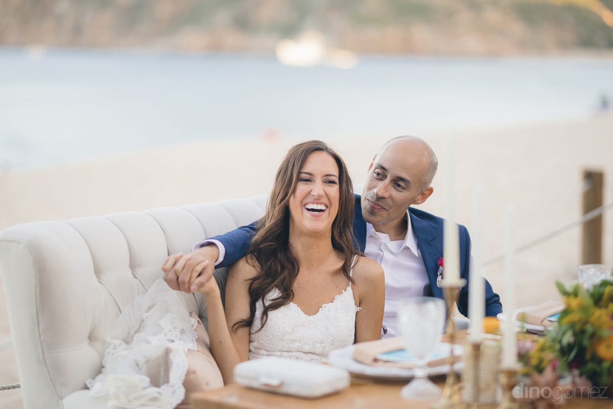 The adorable couple is enjoying their time sitting on the couch at the beachside- Nikki and David