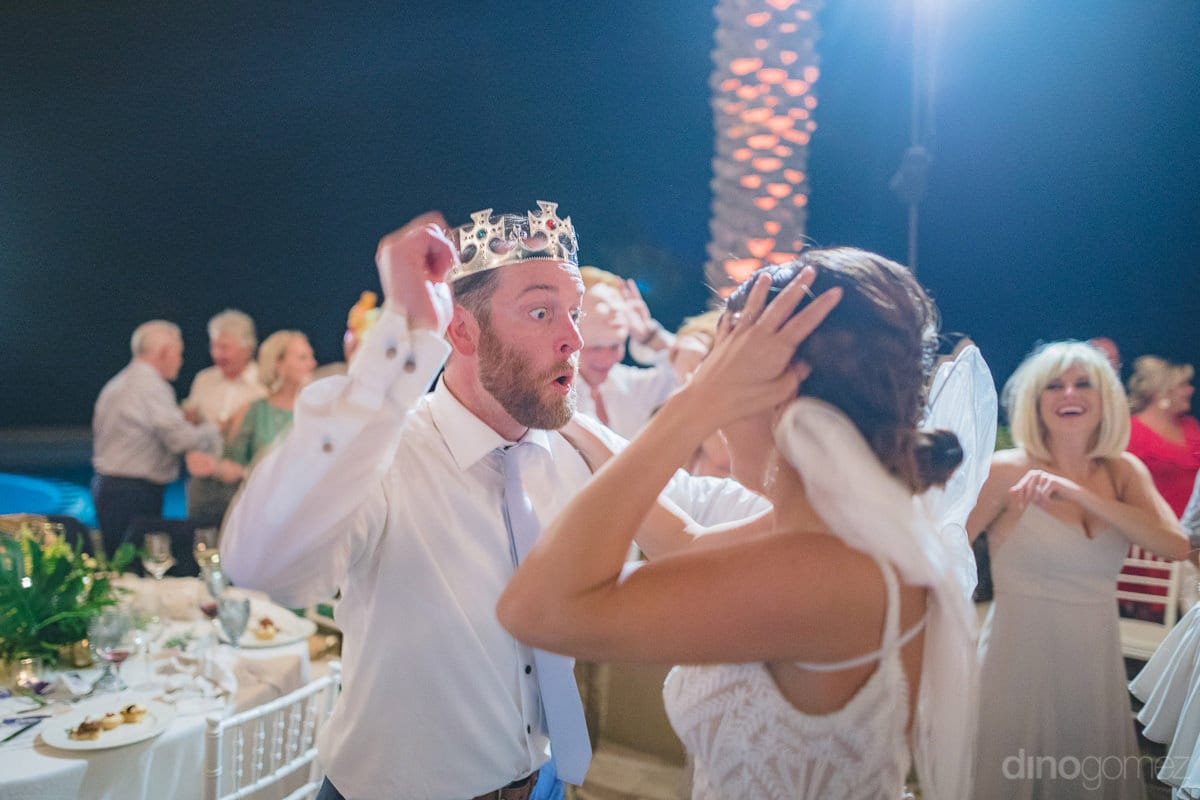Handsome groom and beautiful bride can be seen dancing madly at their reception party using the props on- Kathleen & Kevin