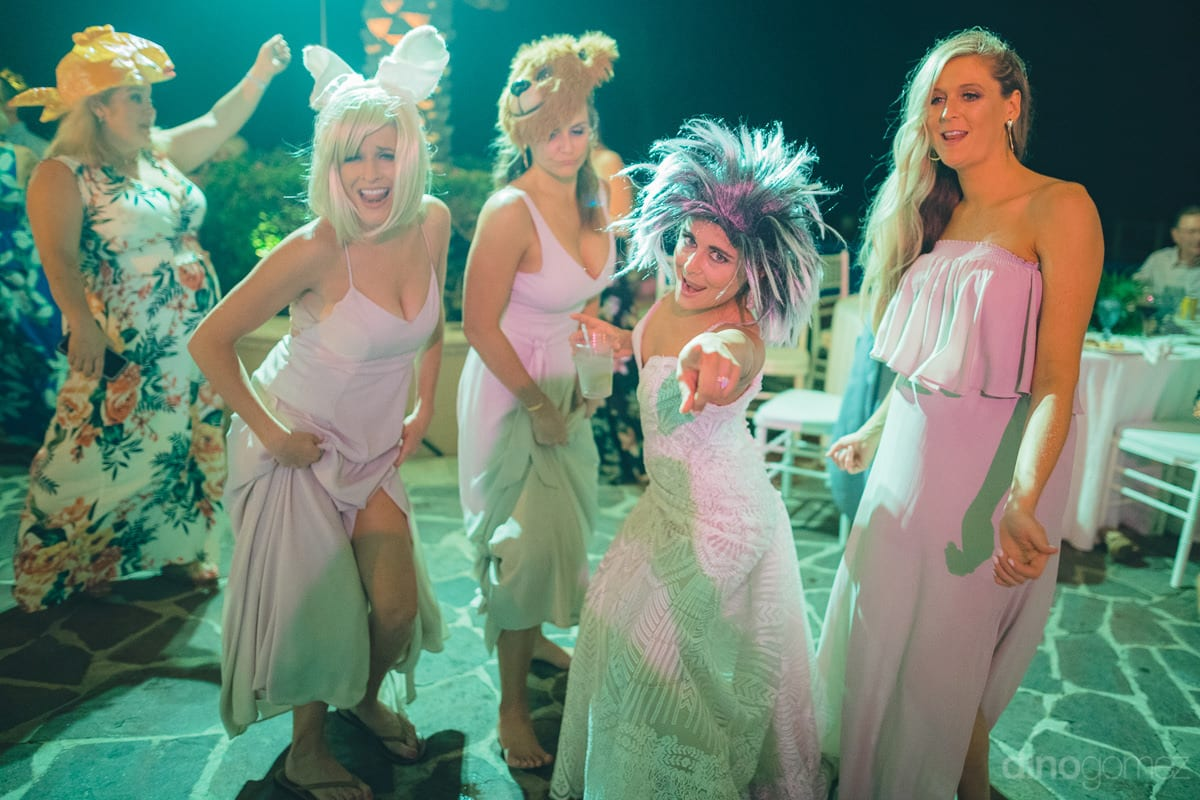 The bride and her friends are wearing different hair wigs and are enjoying the dance party to the fullest- Kathleen & Kevin