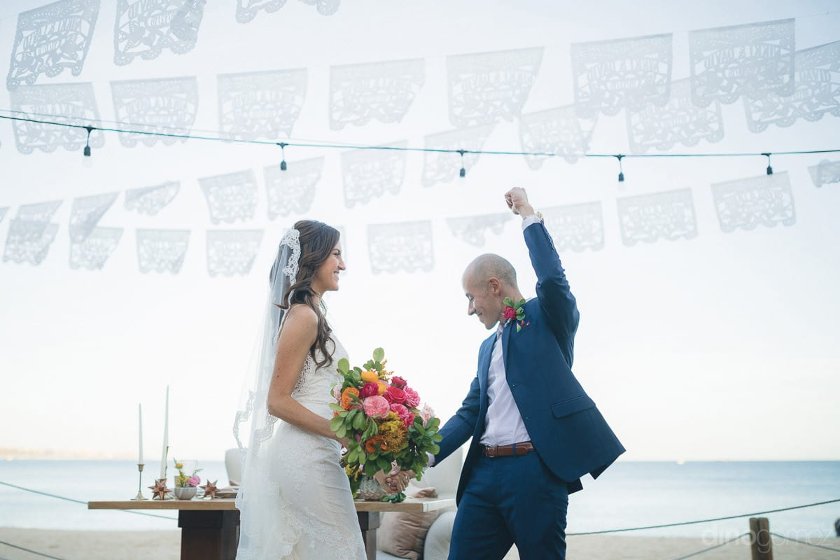 The lovely bride and groom are enjoying their by dancing at the beachside- Nikki and David