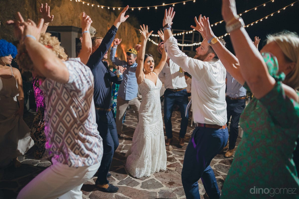 All The Wedding Guests Can Be Seen Performing The Same Dancing Step At The Reception Party Of The Couple- Kathleen & Kevin