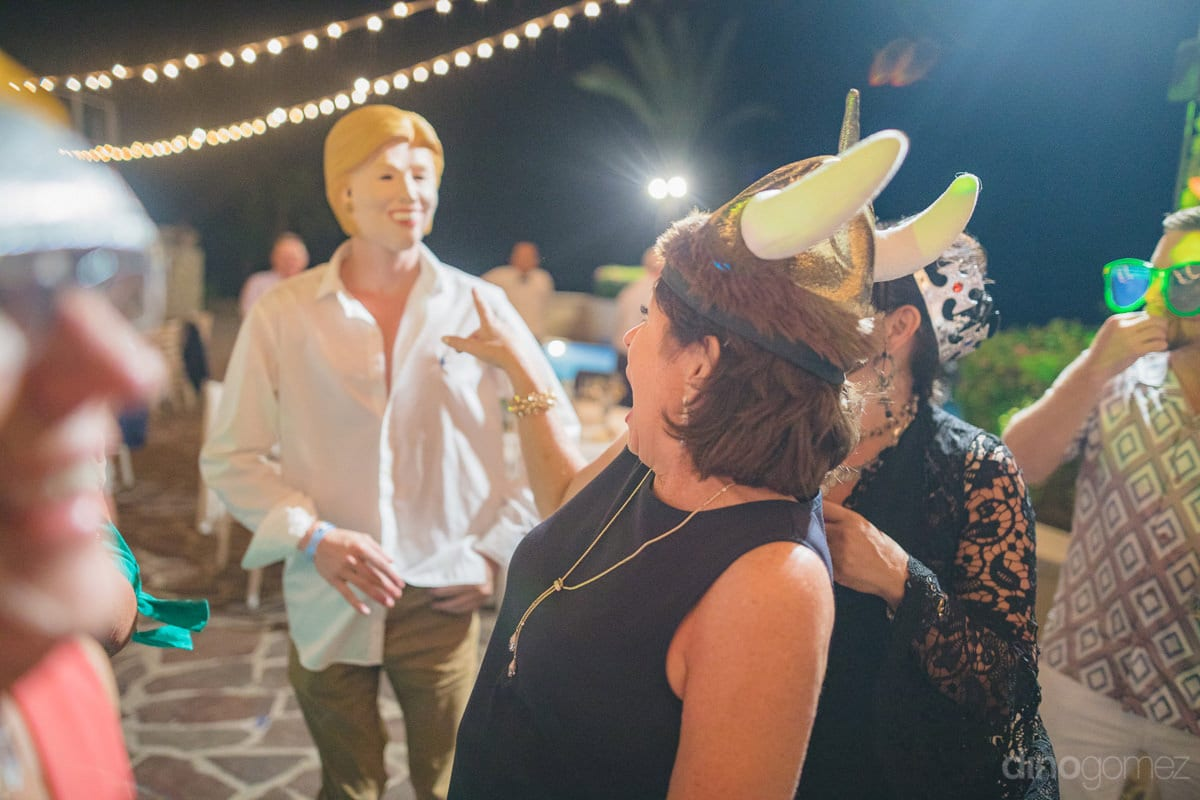 Wedding guests are enjoying the dance and actions of a gentleman wearing a women's face mask at the reception party- Kathleen & Kevin