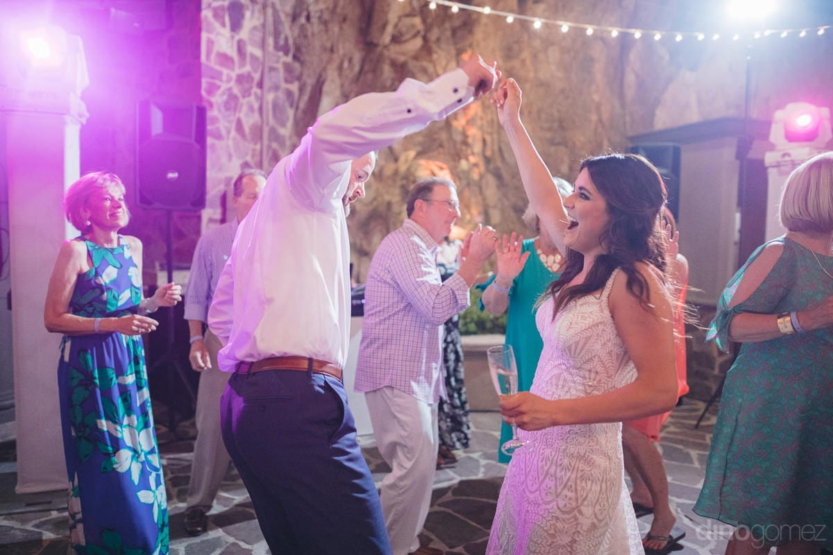 Lovely Bride And Groom Are Dancing Together At The Evening Reception Party Along The Beachside- Kathleen & Kevin