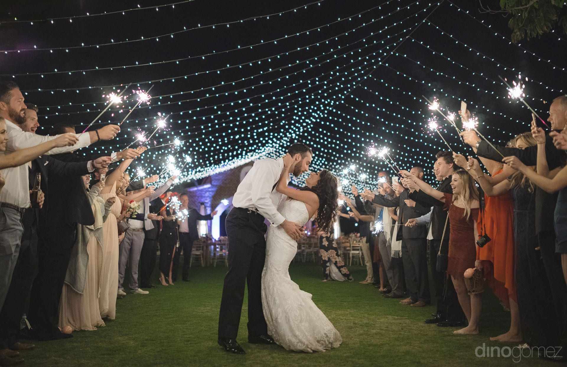 Cabo Photography Bride & Groom kissing under sparklers tunnel - Important Moments