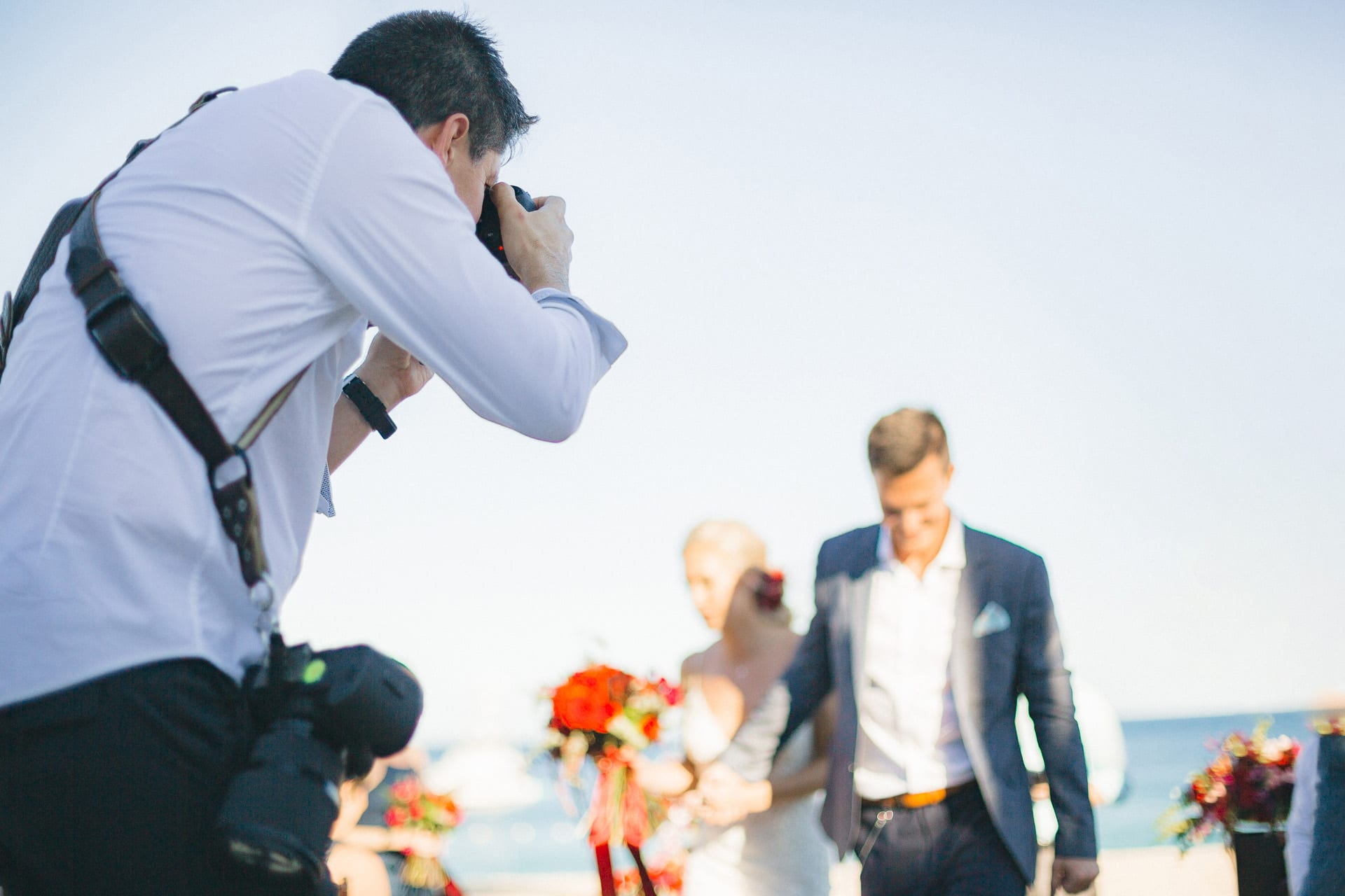 Local wedding photographer Dino Gomez photographing a couple