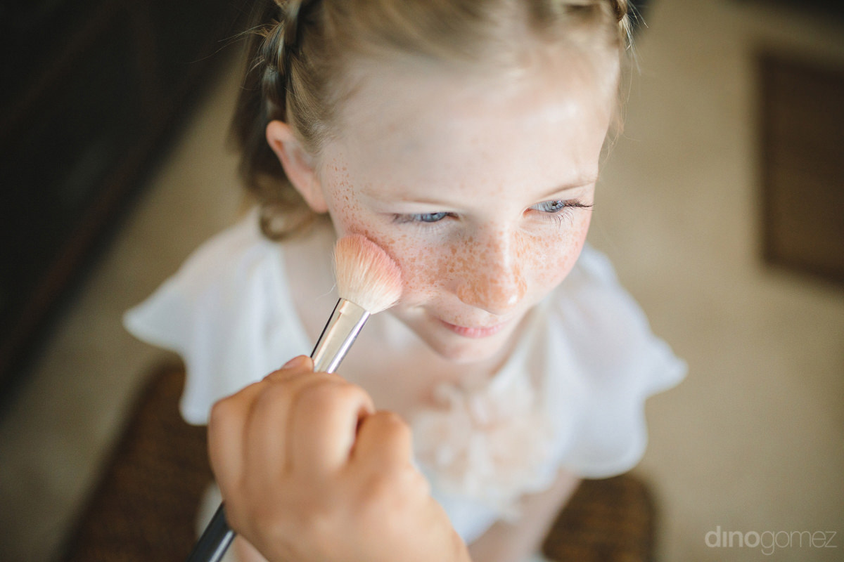 A Young Girl Is Getting Her Blusher Applied By The Makeup Artist Is Captured By The International Photographer-  Lara & Darrell