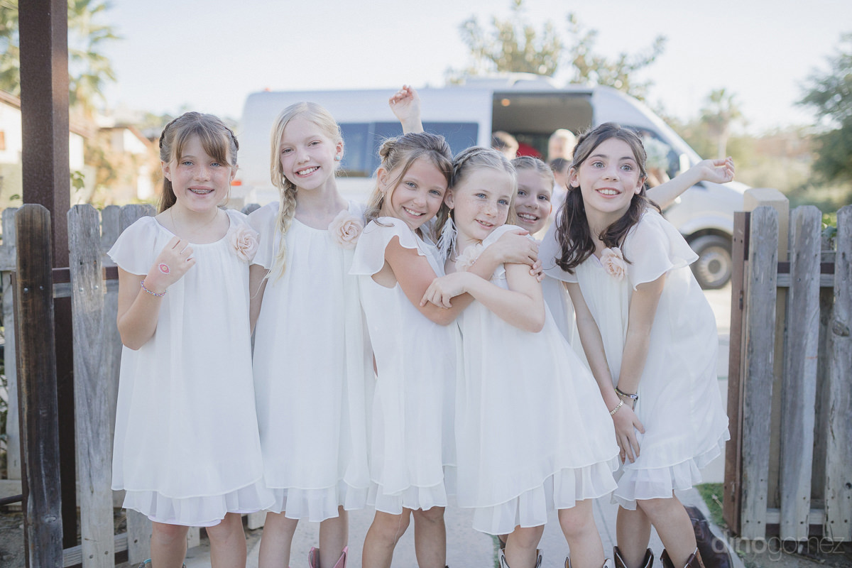 Lovely Young Girls Are Wearing Beautiful White Dresses And Posing For The Destination Wedding Photographer- Lara & Darrell