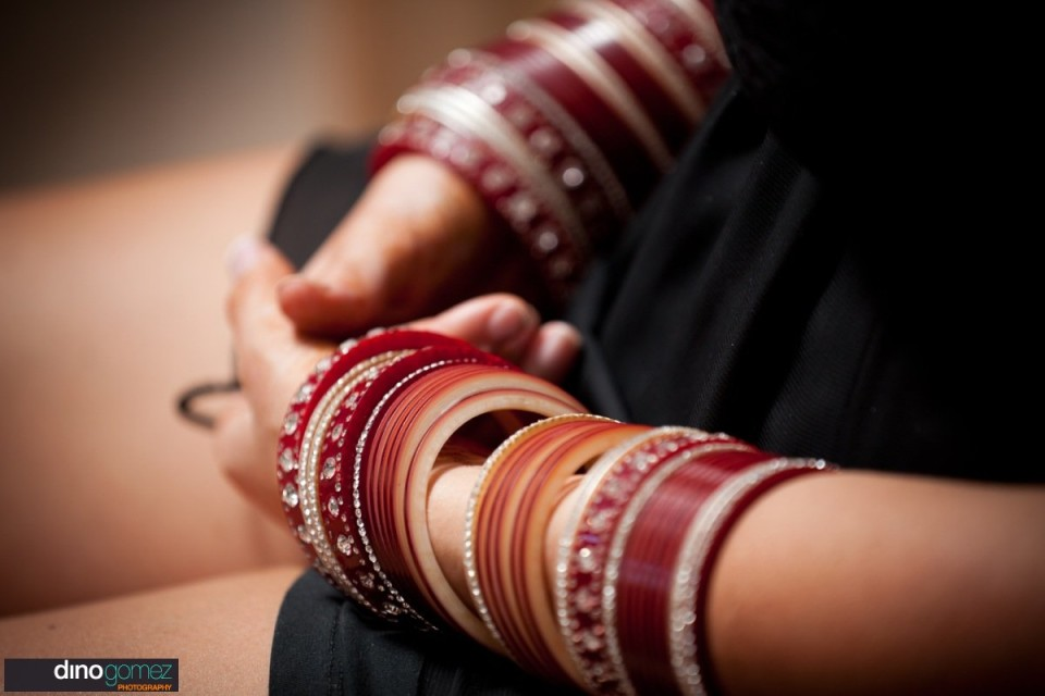 Chic bangles with reddish tone on hands