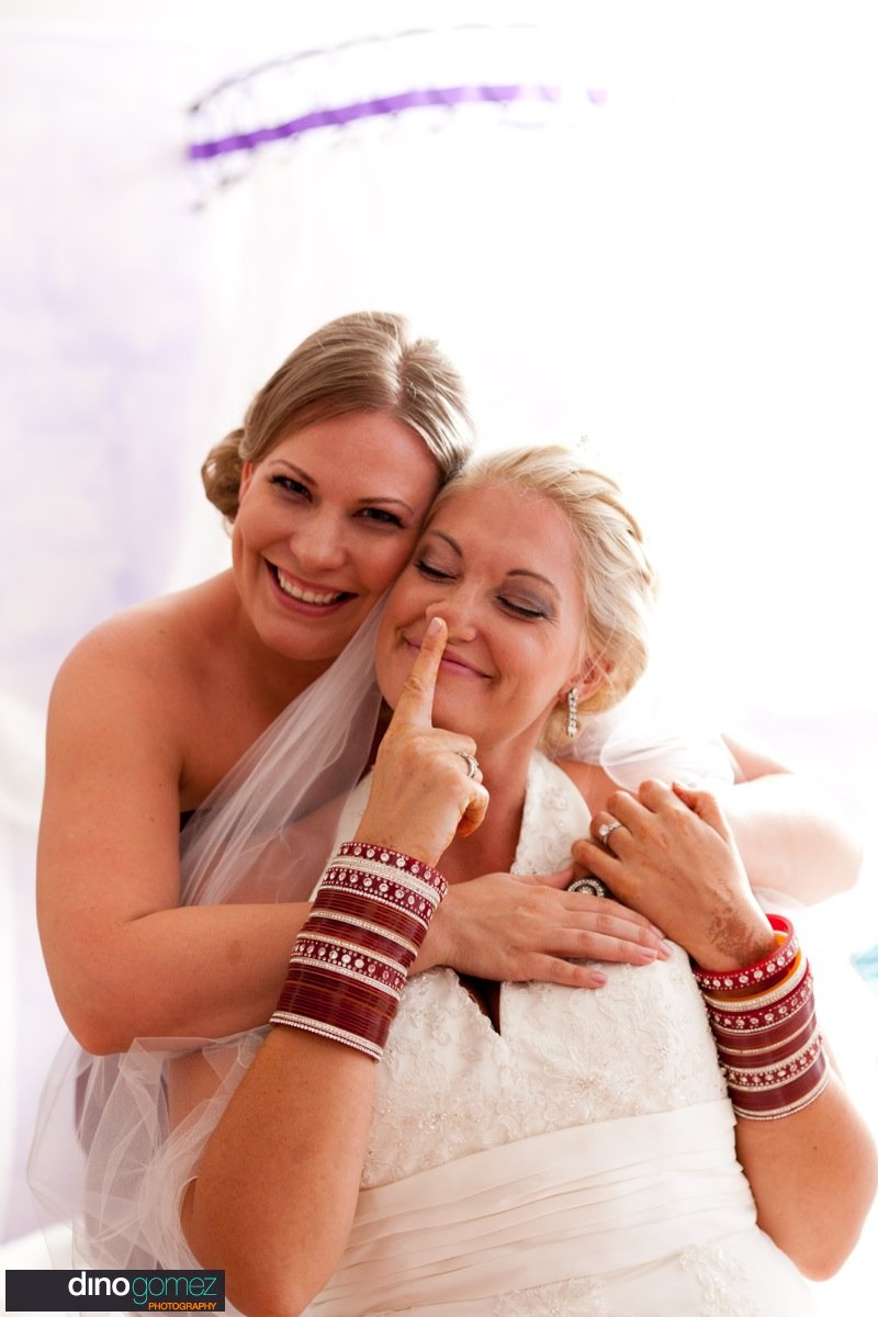 Beautiful capture of a bride getting a hug from one of her friends