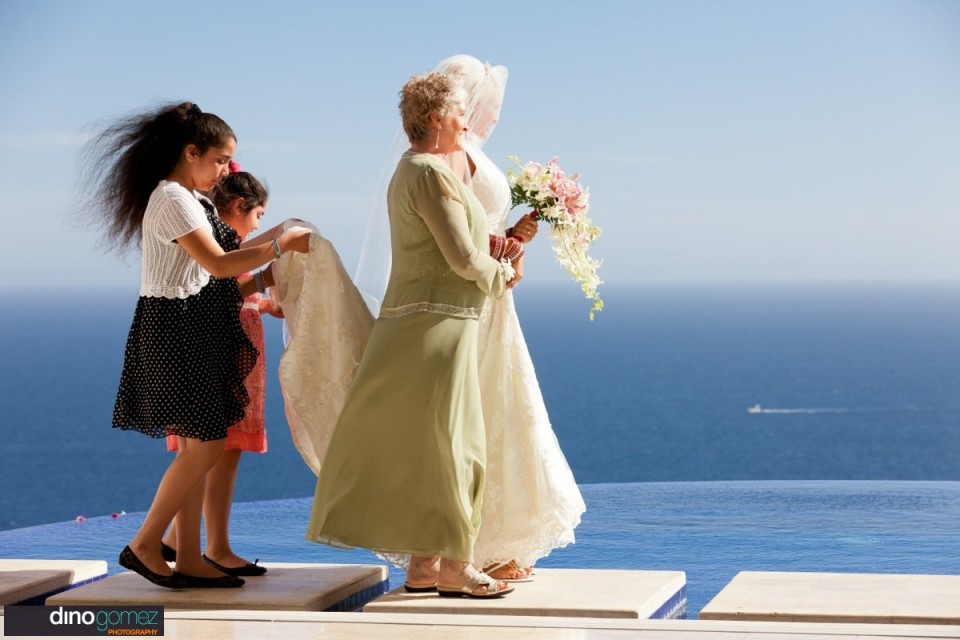 The bride walking down the aisle with her mother and two girls