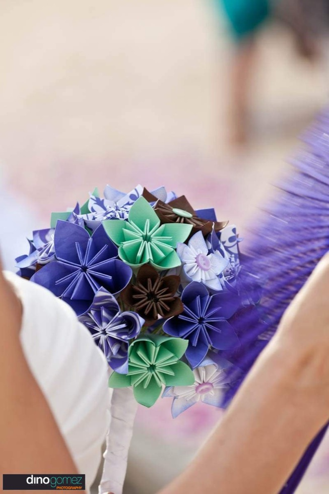 A beautiful close-up image of a paper bouquet in shades of blue and teal