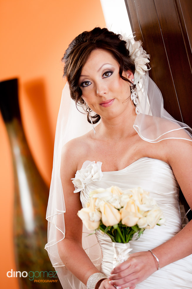 Upper body shot of bride dressed in wedding gown