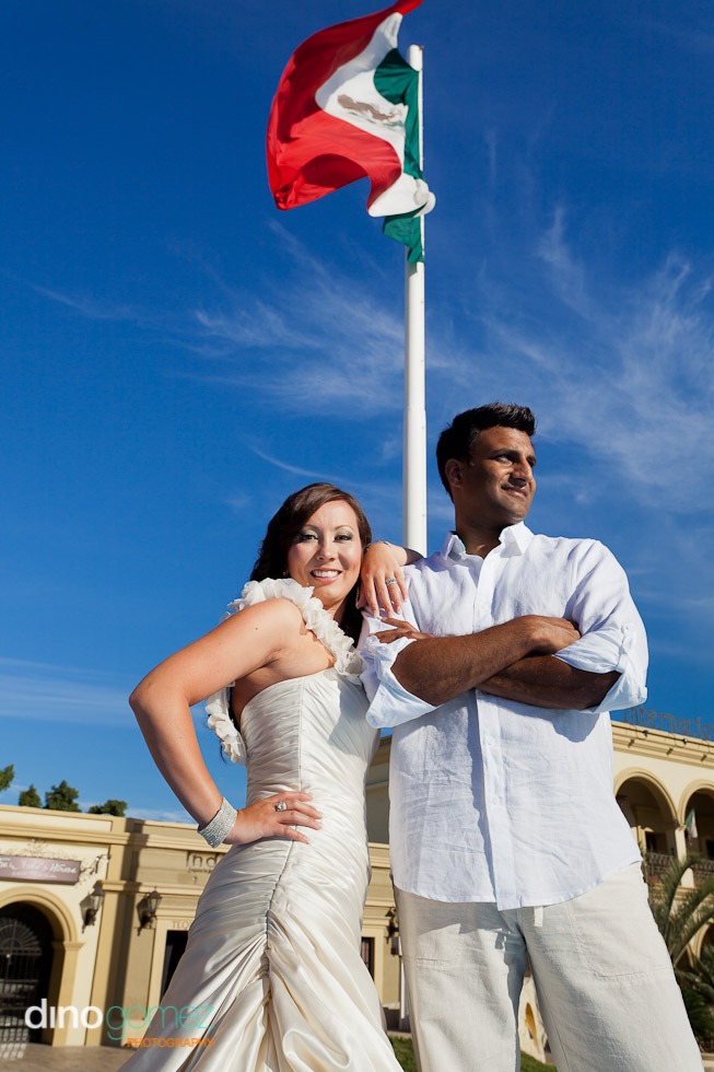 Groom And Bride In Wedding Dress With A Mexican Flag On A Pole
