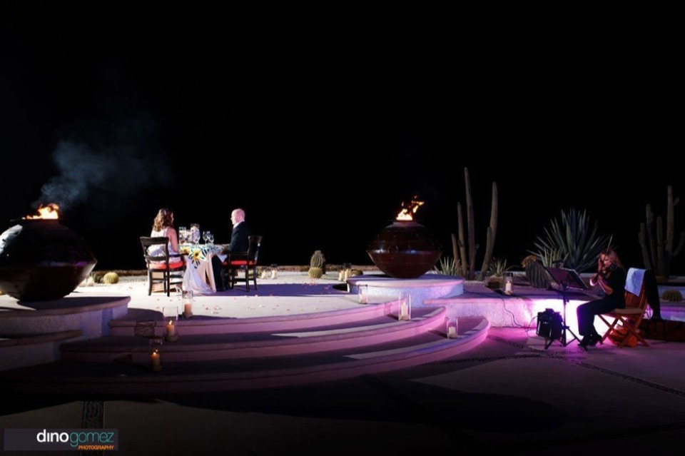 Couple celebrating their wedding with an evening of exquisite outdoor dining