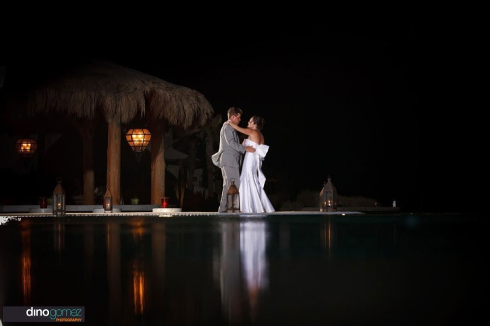 Couple dancing in the night at their destination wedding