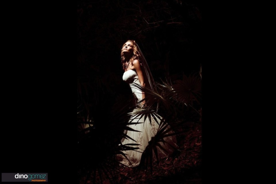 Bride in her wedding dress in the garden looking up at the stars