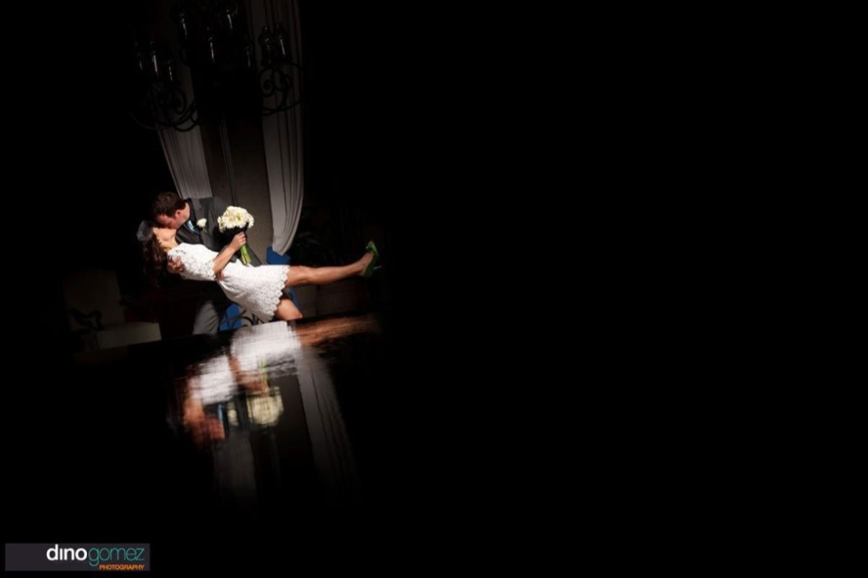 Gorgeous shot of bride and groom kissing at their destination wedding