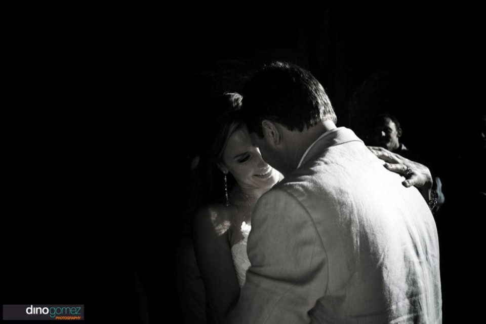 Tender black and white moment between the bride and groom in the night at their destination wedding