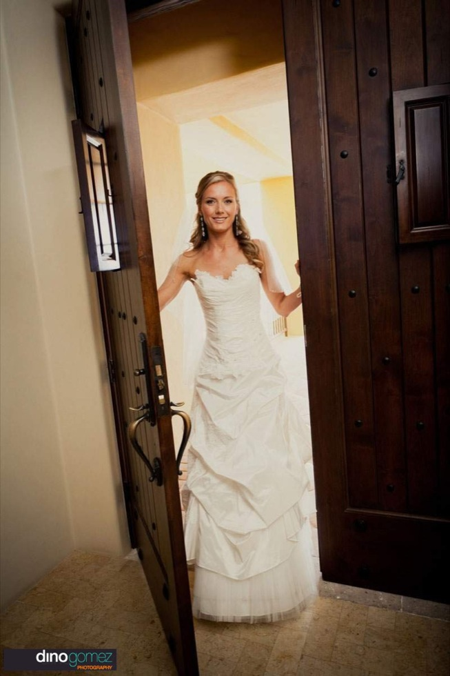 Gorgeous Bride In Full Length Wedding Gown Walking Through Brown Wooden Doors