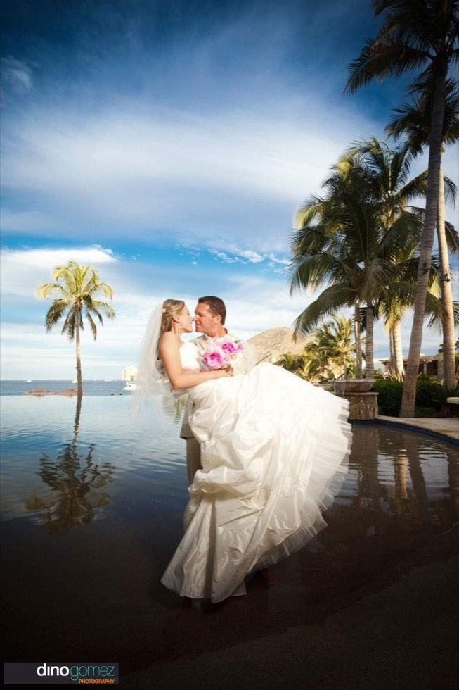 Amazing Wedding Shot Of The Couple, Water And The Sky