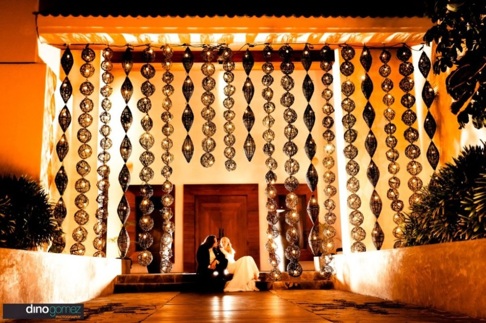 A cool shot of the newlyweds sitting on the stairs by wedding photographer in Cabo Dino Gomez