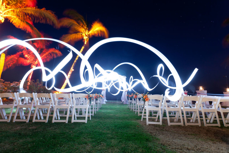 A beautiful effect is created in the darkness around the wedding area with colour ribons of light