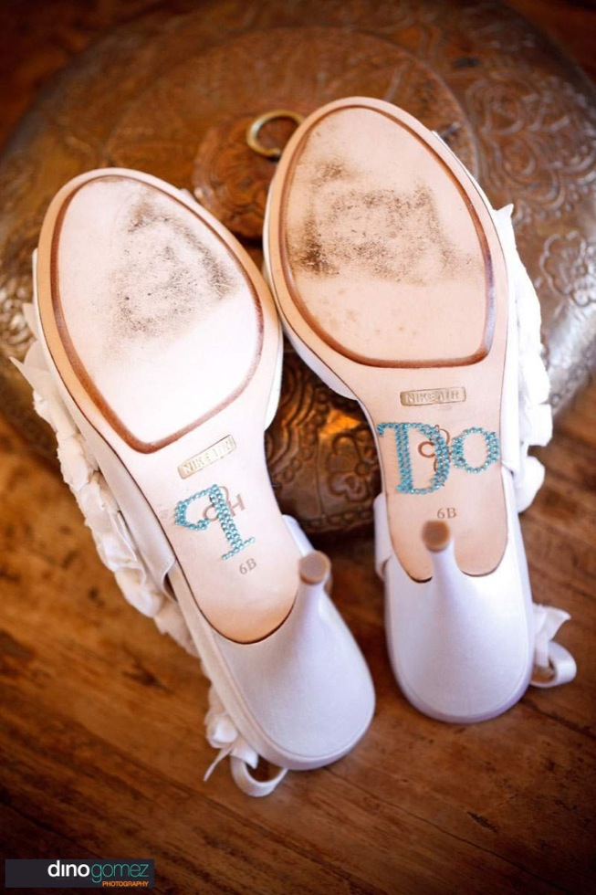 Wedding shoes with the words I Do underneath by destination wedding photographer in Cabo Dino Gomez