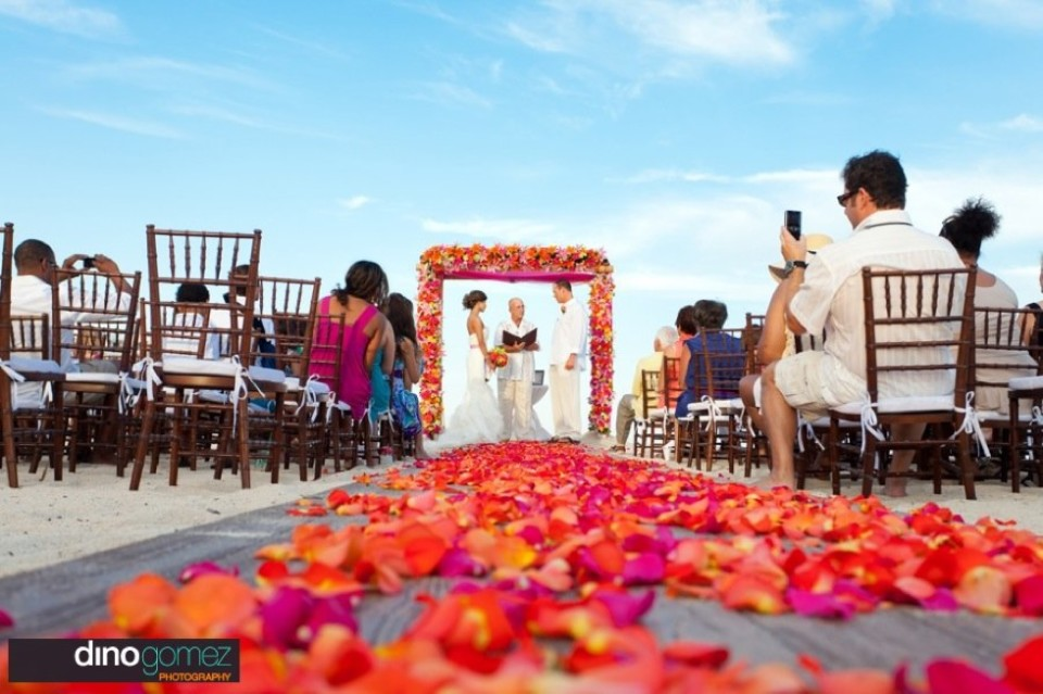 Flower petal aisle with wedding ceremony in the background