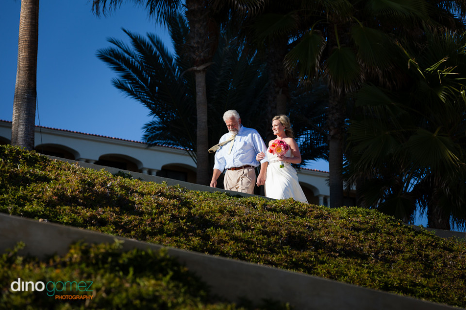 Bride and father walking down the aisle in Mexico