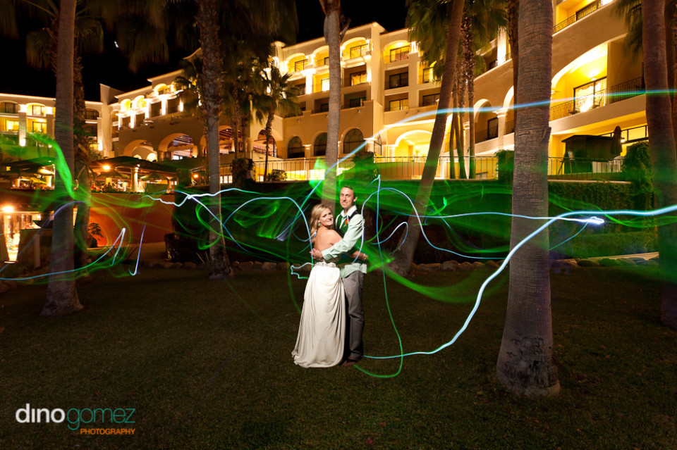 Bride and groom in sweet embrace with floating lights