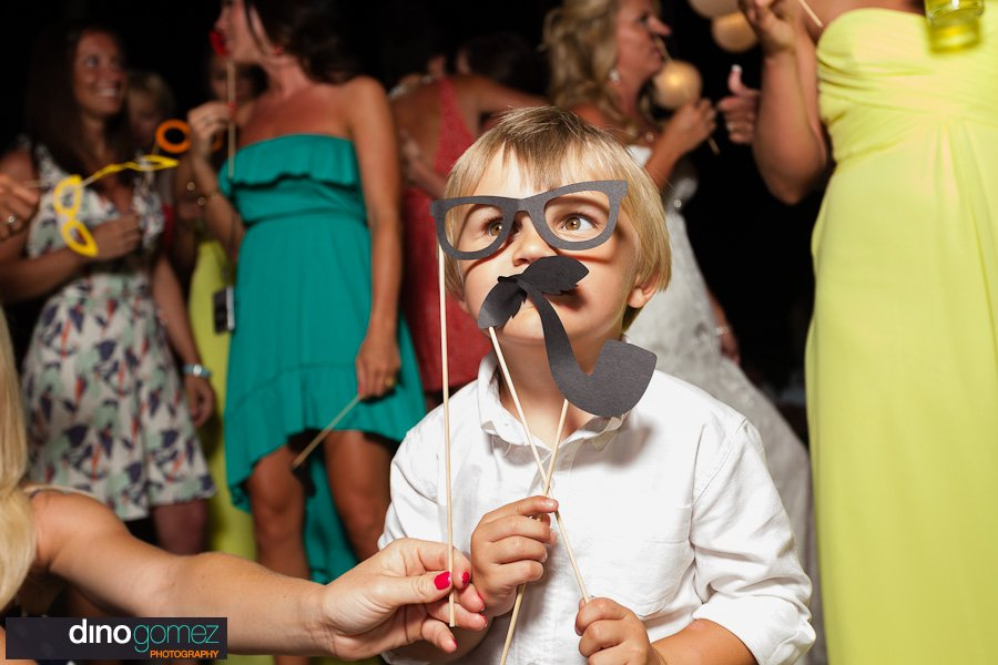 Little boy with fake mustache and eyeglasses