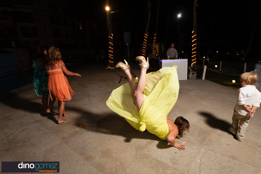 Great shot of the bridesmaid breakdancing by wedding photographer Dino Gomez