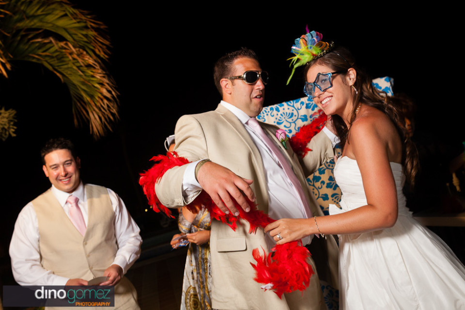 The beautiful bride and groom have fun and dance at their destination weddin in Los Cabos.