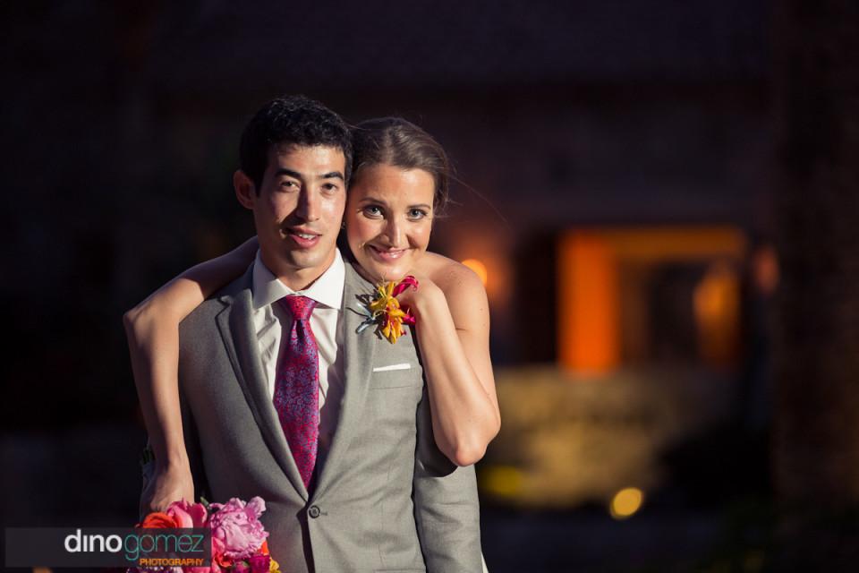 Newlyweds night time shot courtesy of destination wedding photographer Dino Gomez